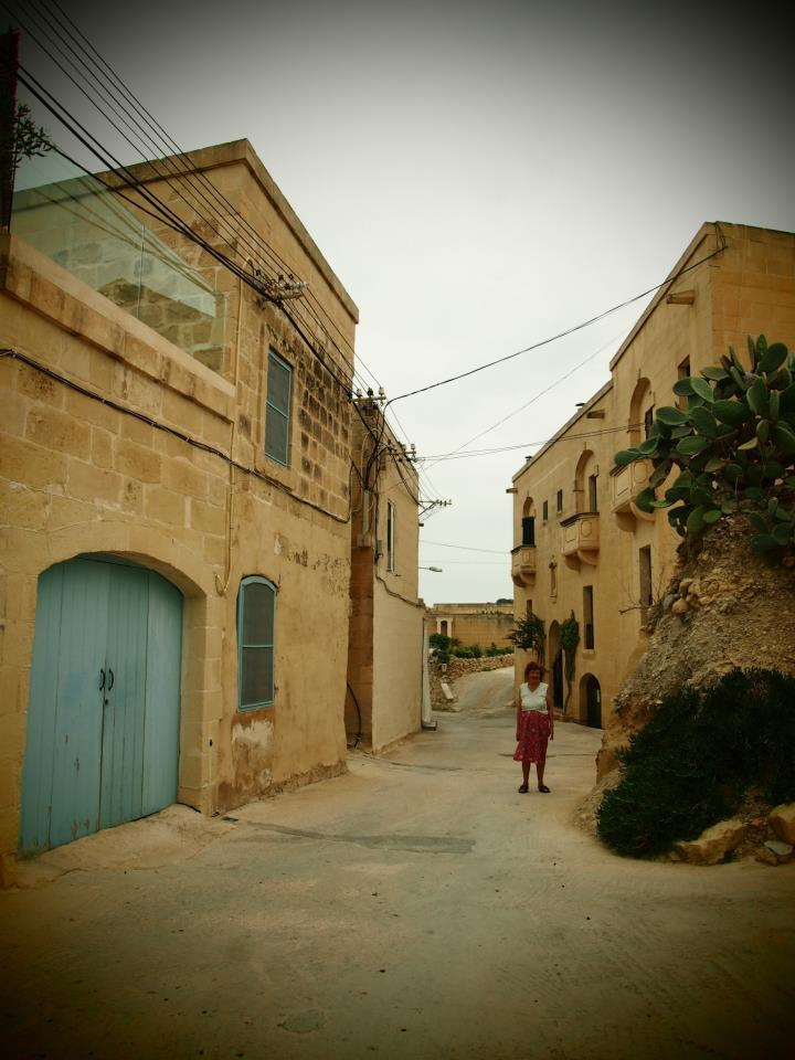 My great aunt in the street she grew up in. The house buznannu Wigi built.